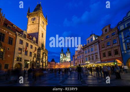 Tourists gather on 'Staromestske Namesti', the main square in the suburb 'Stare Mesto' with 'Tynsky chram', the Tyn Church, at night - Stock Photo
