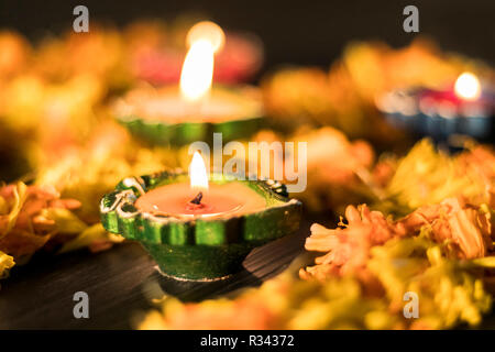 Illuminated diya for wallpaper to celebrate diwali and dhanteras festival in India - Stock Photo