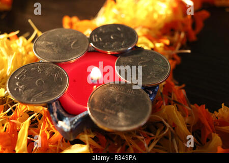 A close- up view of single lit diya for celebrating diwali and dhanteras festival in India - Stock Photo