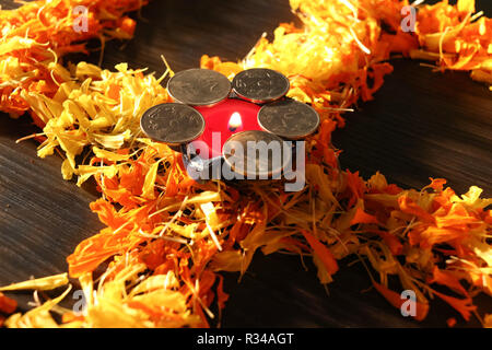 Isolated diya placed on swastik for celebrating diwali and dhanteras festival in India - Stock Photo