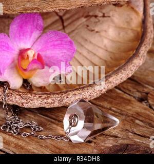 healing pendulum,esotericism - Stock Photo