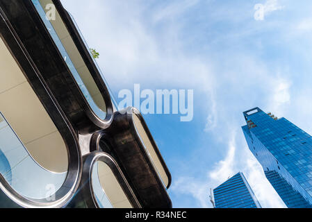 New York City, USA - June 22, 2018: Low angle view of  Condominium Residences, a modern building designed by Zaha Hadid Architects along the High Line - Stock Photo