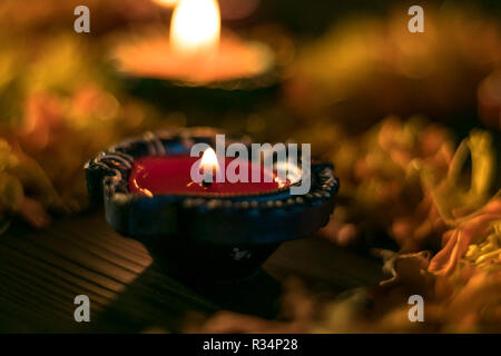 A close-up view of lit diya for celebrating diwali and dhanteras in Asia - Stock Photo