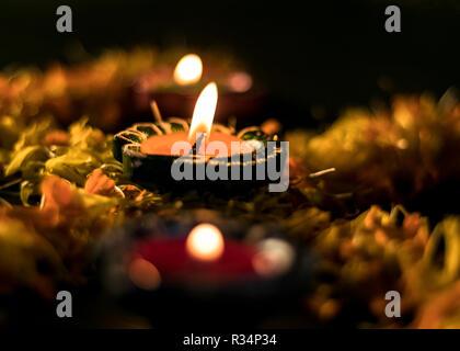 Diya placed on swastik for celebrating diwali and dhanteras in Asia - Stock Photo
