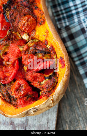 Baked ratatouille in a pumpkin - Stock Photo