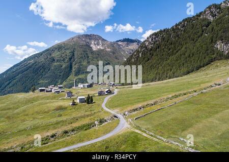Valtellina, road and small village in mountain. Village of Eita in Valgrosina - Stock Photo
