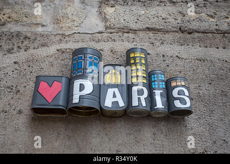 PARIS, FRANCE, SEPTEMBER 6, 2018 - Paris written and painted on tin cans on a wall of Paris, France. - Stock Photo