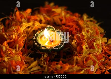 A typical view of lit diyas to celebrate diwali and dhanteras in Asia - Stock Photo