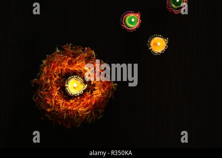 A top view of illuminated diyas to celebrate diwali and dhanteras in Asia - Stock Photo
