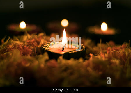 Diya placed on swastik for celebrating diwali and dhanteras in Asia - Stock Photo