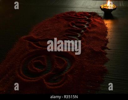Diwali written in rangoli for celebrating diwali and dhanteras in India - Stock Photo