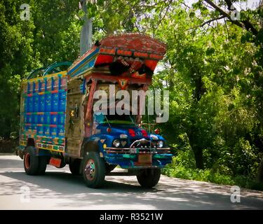 Decorated truck at the road - 07 May 2015 at Karakoram highway, Pakistan - Stock Photo