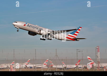 American Airlines Boeing 777 N773AN takes off at London Heathrow Airport, UK - Stock Photo