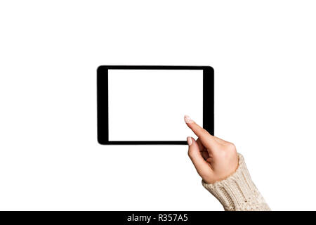 Christmas online shopping. female hands in sweater using tablet pc with white screen, isolated on white background. - Stock Photo