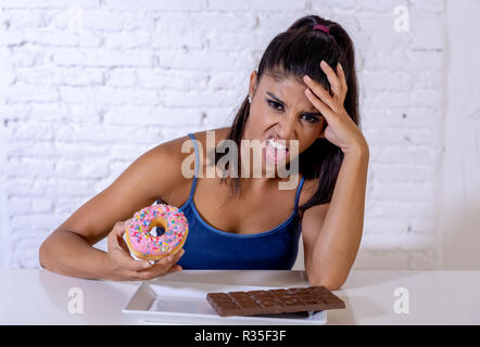 Attractive healthy fit woman rejecting donuts and chocolate in no more junk unhealthy food, Diet, Healthy eating Habits - Stock Photo