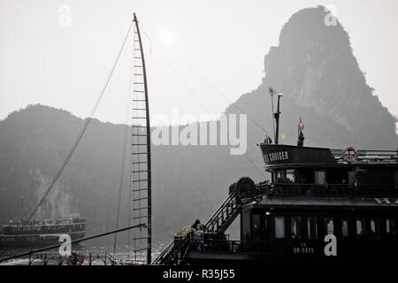 Halong bay, Vietnam - May 11, 2013: Typical wooden boats for tourists sailing through the Cat Ba area, in Ha Long Bay. - Stock Photo