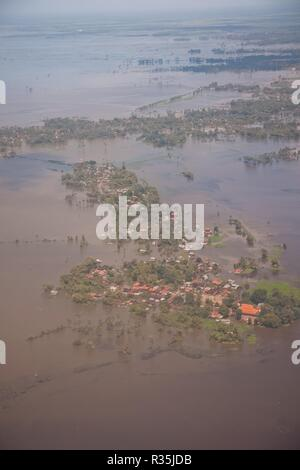 Non Pem, Cambodia - 26 October 2011: Floods in Southeast Asia seen from an airplane, aerial view. - Stock Photo