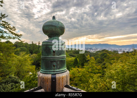 A japanese temple detail over a huge green forest in a cloud day in Kyoto, Japan - Stock Photo