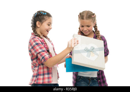 kids little girls with braids hairstyle hold gift box children excited about unpacking gift