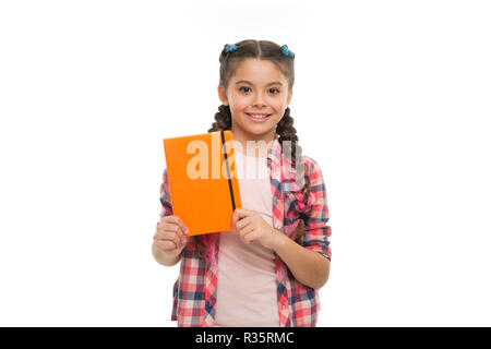Child cute girl hold notepad or diary isolated on white background. Diary writing for children. Childhood memories. Diary for girls concept. Note secrets down in your cute girly diary journal. - Stock Photo