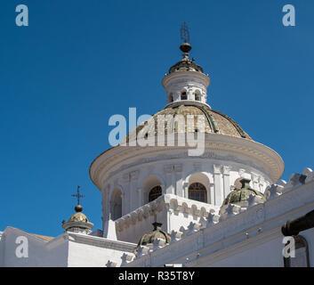 The white dome of the Basilica Nuestra Senora de la Merced in Quito stands out in the blue sky, Ecuador - Stock Photo