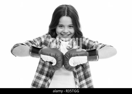 Happy girl in boxing gloves isolated on white. Little child smile in boxing pose. Kid boxer ready to fight. Sport workout and training. Fit to win. - Stock Photo
