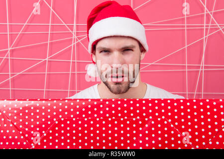 The morning before Xmas. man enjoy the holiday. man in santa hat hold christmas present. delivery christmas gifts. Are you ready. New year new goals. Capturing a happy moment. - Stock Photo