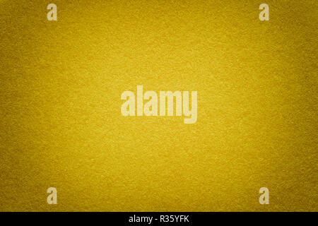 Texture of vintage dark yellow paper background with vignette. Structure of dense light golden kraft cardboard with frame. Felt gradient backdrop clos - Stock Photo