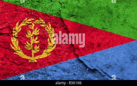 Flag of Eritrea close up painted on a cracked wall, concept of armed actions and conflicts in the world - Stock Photo