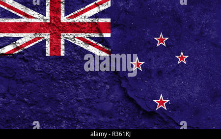 Flag of New Zealand close up painted on a cracked wall, concept of armed actions and conflicts in the world - Stock Photo