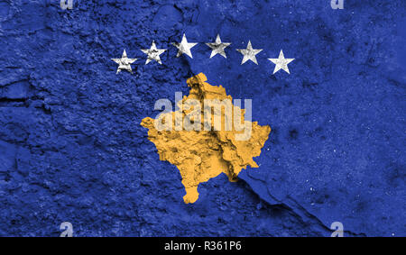 Flag of Kosovo close up painted on a cracked wall, concept of armed actions and conflicts in the world - Stock Photo