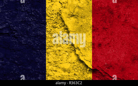Flag of Chad close up painted on a cracked wall, concept of armed actions and conflicts in the world - Stock Photo