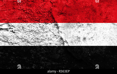 Flag of Yemen close up painted on a cracked wall, concept of armed actions and conflicts in the world - Stock Photo