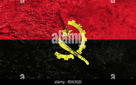 Flag of Angola close up painted on a cracked wall, concept of armed actions and conflicts in the world - Stock Photo