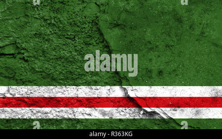 Flag of Chechen Republic of Ichkeria close up painted on a cracked wall, concept of armed actions and conflicts in the world - Stock Photo