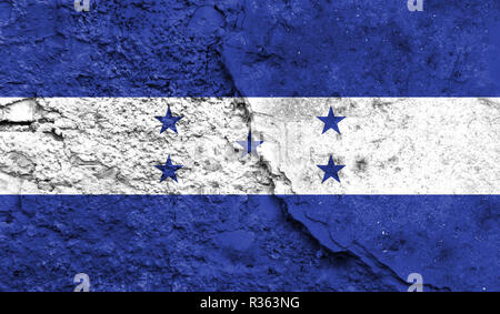 Flag of Honduras close up painted on a cracked wall, concept of armed actions and conflicts in the world - Stock Photo