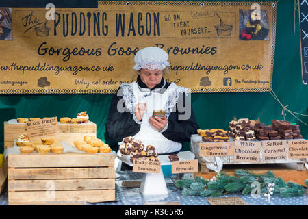 The Pudding Wagon Brownies market stall holder at Gloucester Quays Victorian Christmas Market, Gloucester, Gloucestershire in November. - Stock Photo