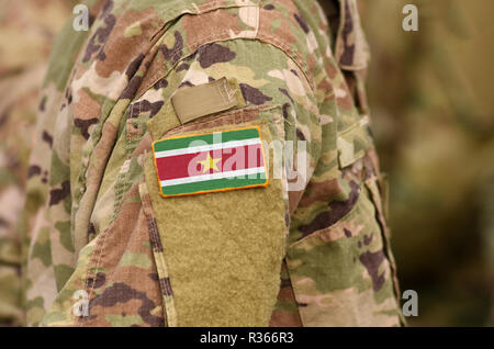 Suriname flag on soldiers arm. Suriname army (collage) - Stock Photo