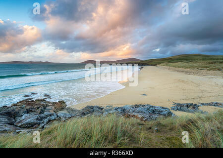 The beach at Traigh Lar near Horgobost on the Isle of Harris, looking out towards the hills of Taransay - Stock Photo