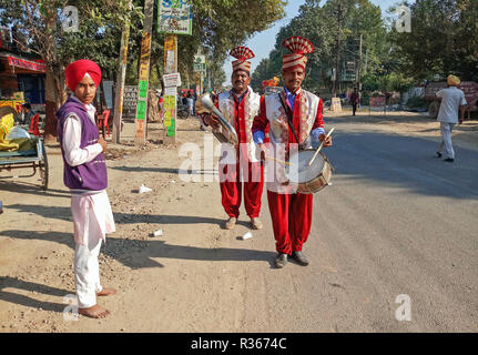 Sikh musicians are seen participating during the Nagar Keertan (Holy Procession) in Chandigarh. A religious procession was held in the region ahead of the birth anniversary of Guru Nanak Dev, the founder of the Sikh faith, which will be celebrated across the country on November 23. - Stock Photo