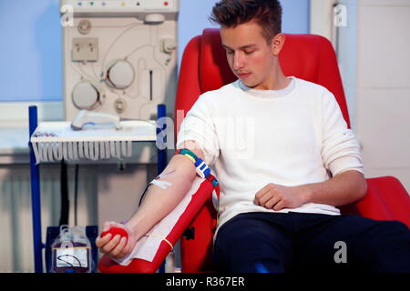 Patient taking blood at the transfusion ward of a hospital - Stock Photo