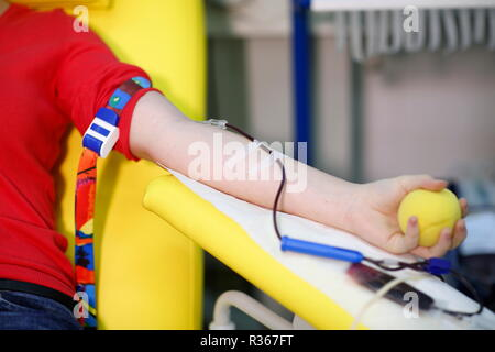 Detail of blood collection from the patient's hand - Stock Photo