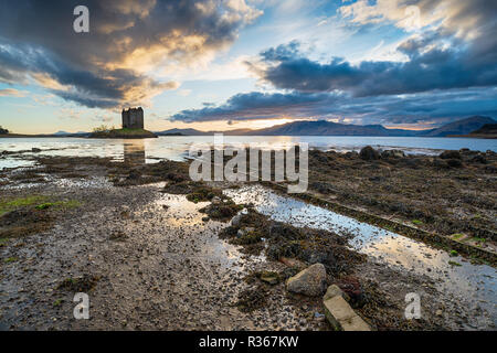 Dramatic skies over Castle Stalker at Appin the Scottish highlands - Stock Photo