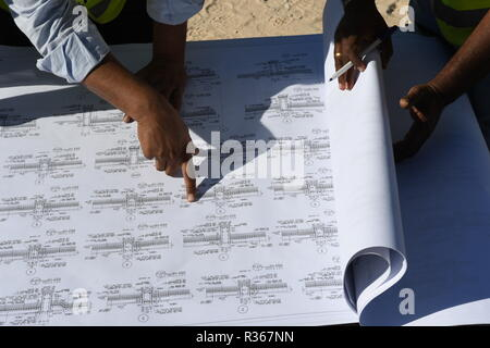 Skilled Engineers are doing daily Work Inspections to make sure the work has no problems - Stock Photo