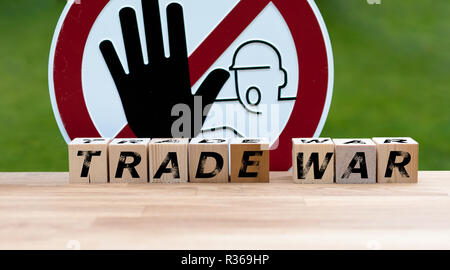 Dices form the words 'TRADE WAR' infront of a stop sign - Stock Photo