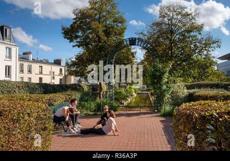 People enjoying The Promenade Plantee or Coulee verte Rene-Dumont, Elevated park in 12th arrondissement, Paris, France - Stock Photo