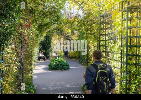 People enjoying The Promenade Plantee or Coulee verte Rene-Dumont, Elevated park in 12th arrondissement, Paris, France - Stock Photo