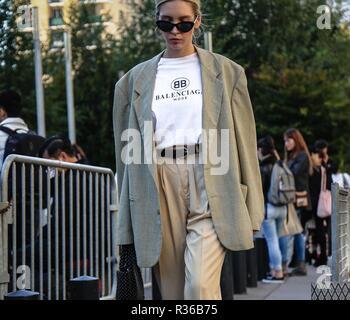 PARIS, France- September 27 2018: Women on the street during the Paris Fashion Week. - Stock Photo