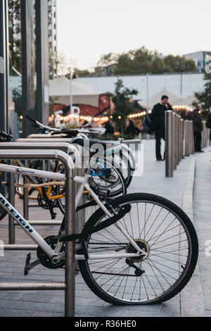 London, UK - November 02, 2018: A row of bikes parked on the street in London. Cycling is a popular way to commute in the city. Stock Photo