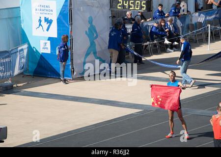 36th Athens Authentic Marathon. Ma Liang Wu from China crossing the finish line at Panathenaic stadium - Stock Photo